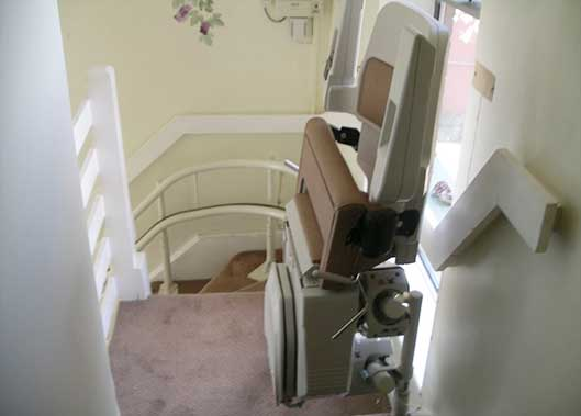 A curved stairlift specially tailored to the staircase