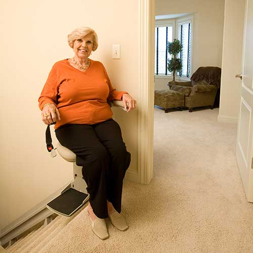 Happy lady riding stair lift